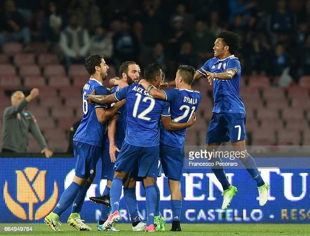 Players of Juventus FC celebrate after scoring the 01 goal scored by Gonzalo Higuain during the TIM Cup match between SSC Napoli and Juventus FC at...