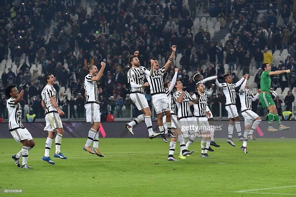 Players of Juventus FC celebrate victory at the end of the Serie A match betweeen Juventus FC and ACF Fiorentina at Juventus Arena on December 13, 2015 in Turin, Italy.