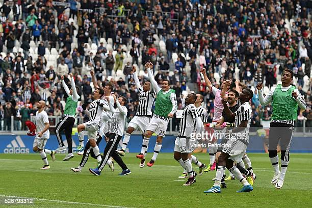 Players of Juventus FC celebrate victory at the end of the Serie A match between Juventus FC and Carpi FC at Juventus Arena on May 1 2016 in Turin...