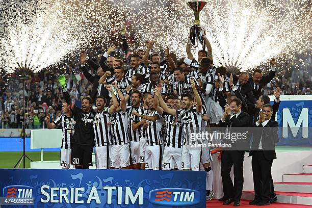Players of Juventus FC celebrate with the Serie A Trophy at the end of the Serie A match between Juventus FC and SSC Napoli at Juventus Arena on May...