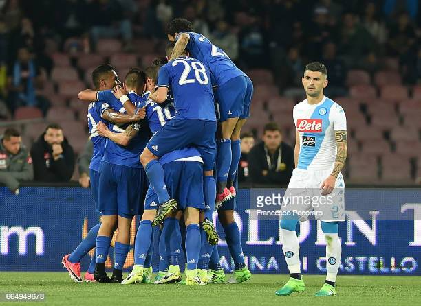 Players of Juventus FC celebrates after the 01 goal scored by Gonzalo Higuain beside the disappointment of Elseid Hysaj player of SSC Napoli during...