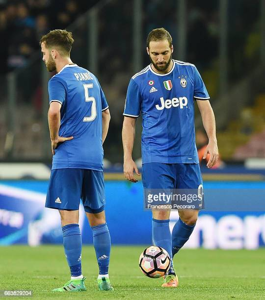 Players of Juventus FC Miralem Pjanic Gonzalo Higuain stand disappointed after the 11 goal scored by Marek Hamsik player of SSC Napoli during the...