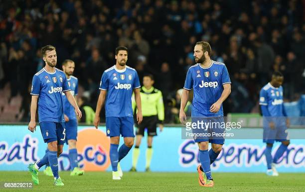 Players of Juventus FC Miralem Pjanic Sami Khedira Gonzalo Higuain stand disappointed after the 11 goal scored by Marek Hamsik player of SSC Napoli...