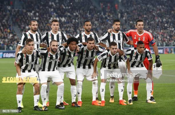 Players of Juventus pose for a photo ahead of the UEFA Champions League group D football match between FC Juventus and Sporting CP at Juventus...