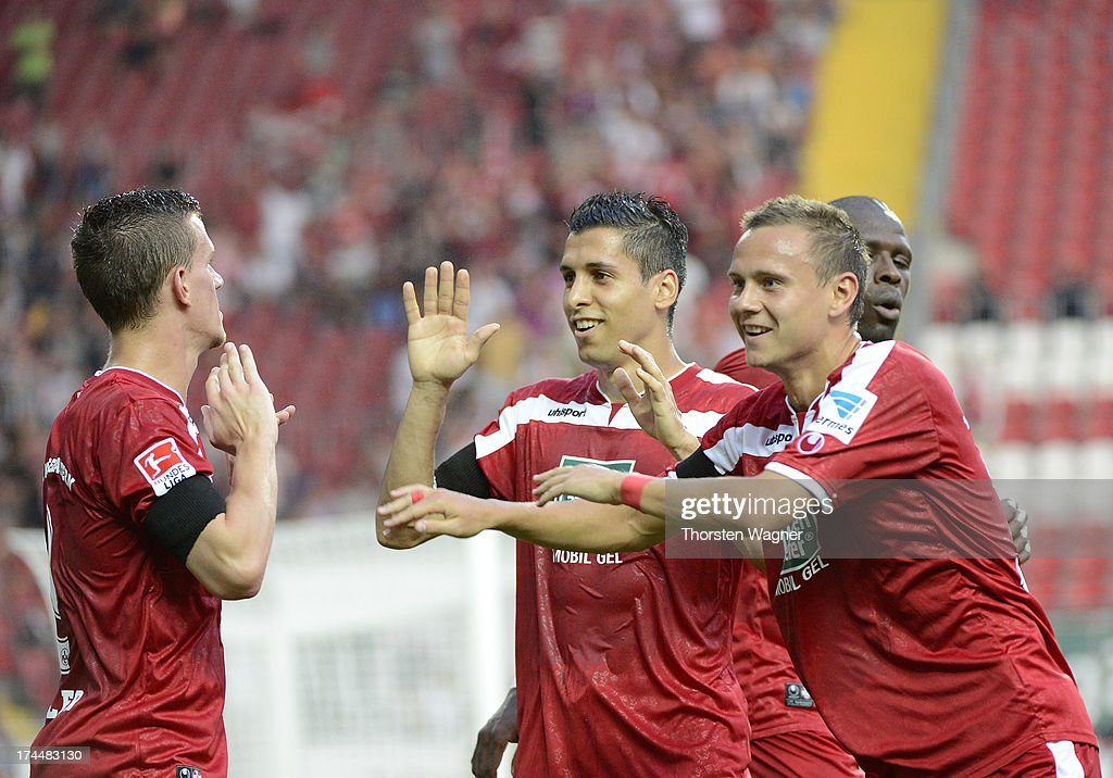 Players of Kaiserslautern celebrates after Simon Zoller is scoring his team first goal during the second Bundesliga match between 1FC Kaiserslautern...
