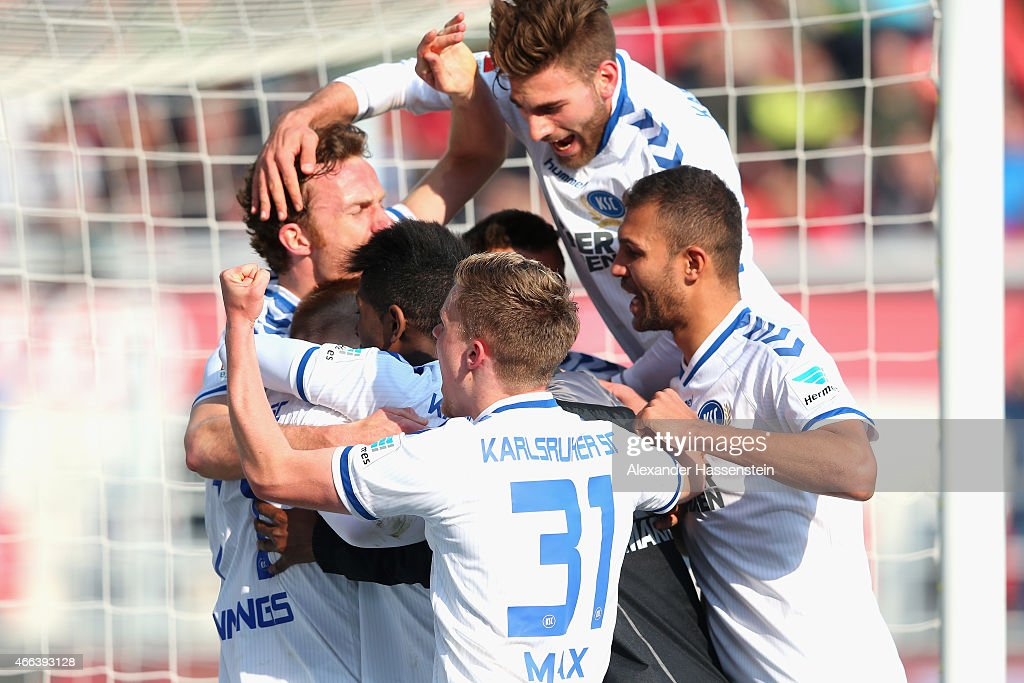 Players of Karlsruhe celebrate the 3rd team goal during the Second Bundesliga match between FC Ingolstadt and Karlsruher SC at Audi Sportpark on...