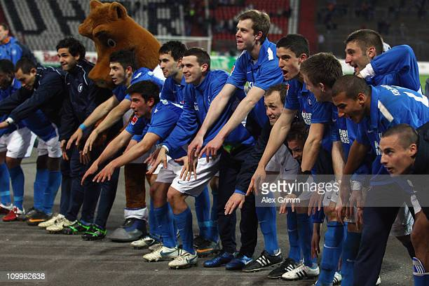 Players of Karlsruhe celebrate with supporters after the Second Bundesliga match between Karlsruher SC and MSV Duisburg at Wildpark Stadium on March...