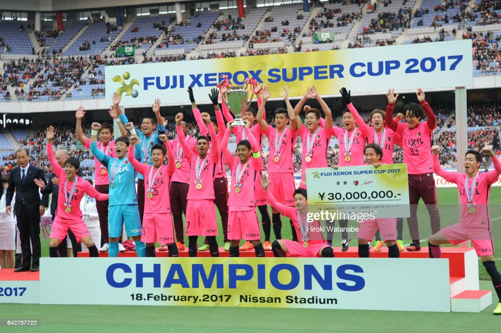 Players of Kashima Antlers celebrate with the trophy after the Xerox Super Cup match between Kashima Antlers and Urawa Red Diamonds at Nissan Stadium on February 18, 2017 in Yokohama, Kanagawa, Japan.
