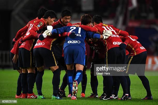 Players of Kashima Antlers huddle during the JLeague Championship Final first leg match between Kashima Antlers and Urawa Red Diamonds at Kashima...