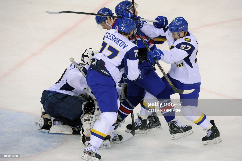 Players of Kazakhstan and Great Britain vie during a 2013 IIHF Ice Hockey World Championship Division I Group A match between their teams in 'Papp Laszlo' Arena of Budapest on April 15, 2013.