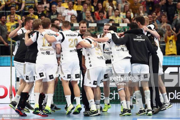 Players of Kiel celebrate after winning the EHF Champions League Quarter Final Leg 2 match between Rhein Neckar Loewen and THW Kiel at SAP Arena on...