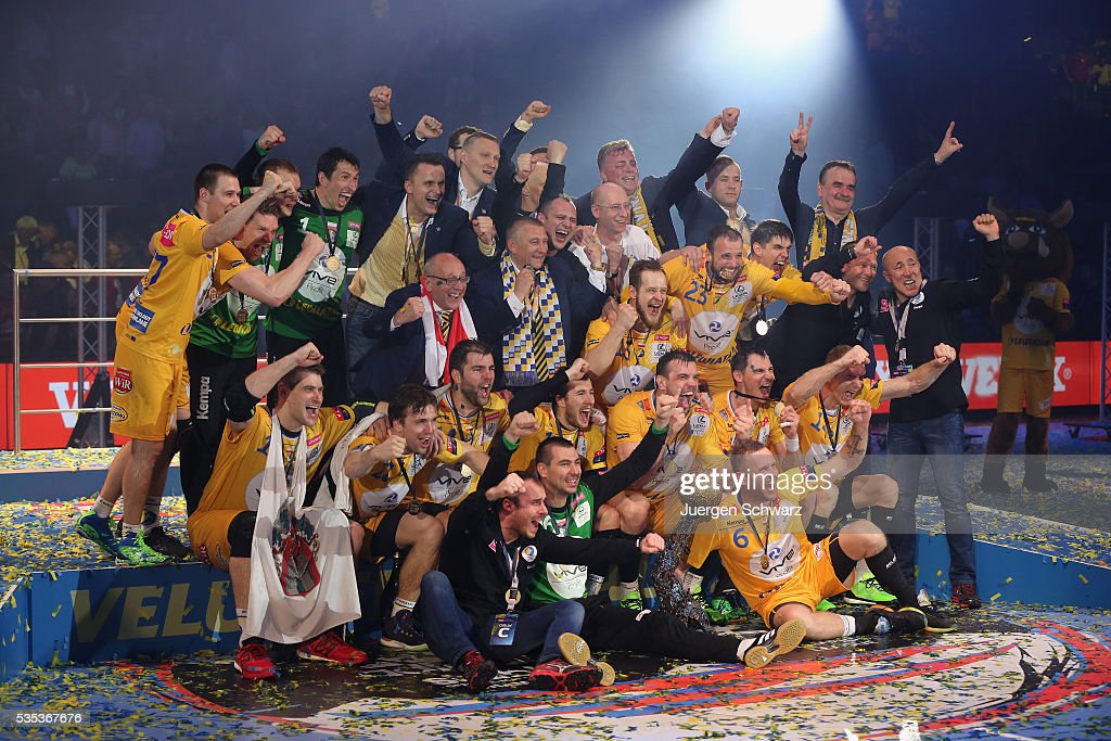 Players of Kielce celebrate on the podium after winning the EHF Champions League Final against MKB Veszprem on May 29, 2016 in Cologne, Germany.