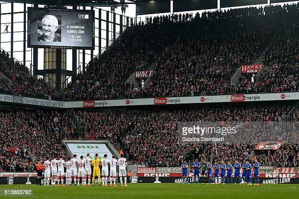 Players of Koeln and Schalke observe a minute of silence for deceased Hannes Loehr prior to the Bundesliga match between 1 FC Koeln and FC Schalke 04...