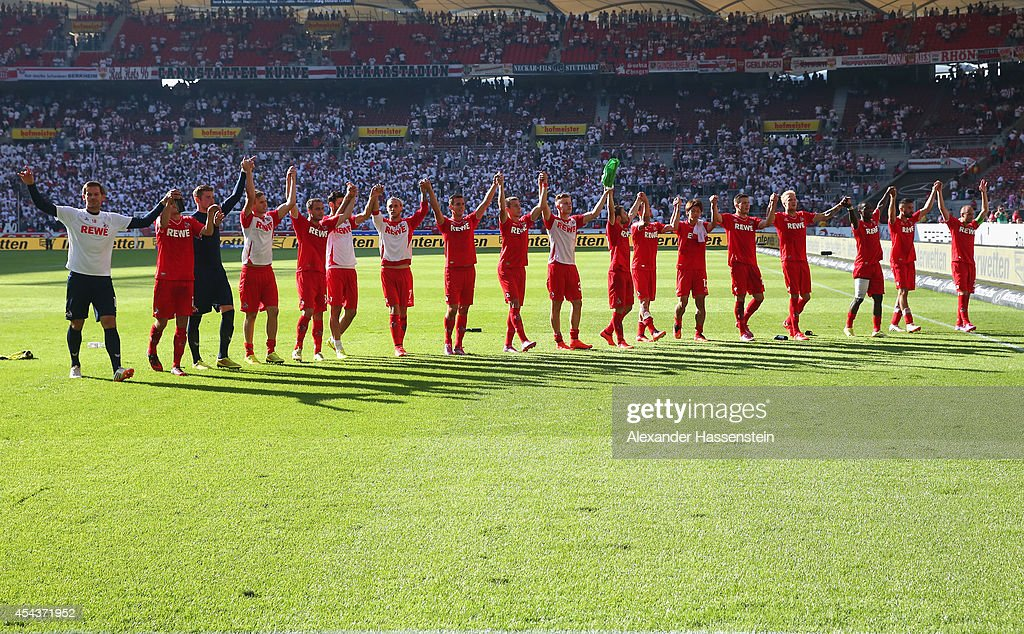 Players of Koeln celebrate after winning the Bundesliga match between VfB Stuttgart and 1. FC Koeln at Mercedes-Benz Arena on August 30, 2014 in Stuttgart, Germany.