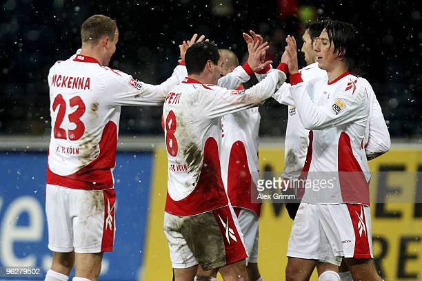Players of Koeln celebrate after winning the Bundesliga match between Eintracht Frankfurt and 1 FC Koeln at the Commerzbank Arena on January 30 2010...