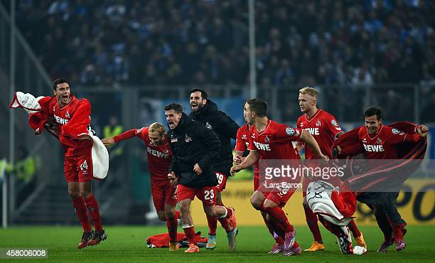 Players of Koeln celebrate after winning the DFB Cup second round match between MSV Duisburg and 1 FC Koeln at SchauinslandReisenArena on October 28...