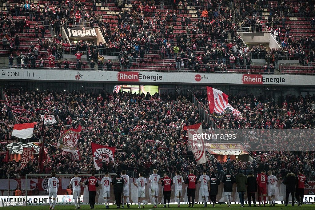 Players of Koeln celebrate with fans after the Bundesliga match between 1. FC Koeln and Bayer 04 Leverkusen at RheinEnergieStadion on December 21, 2016 in Cologne, Germany.