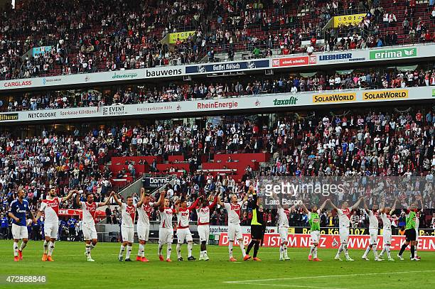Players of Koeln celebrate with the fans after the Bundesliga match between 1 FC Koeln and FC Schalke 04 at RheinEnergieStadion on May 10 2015 in...