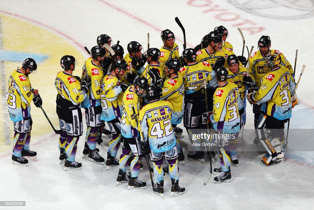 Players of Krefeld celebrate after the DEL match between Adler Mannheim and Krefeld Pinguine at SAP-Arena on October 12, 2012 in Mannheim, Germany.