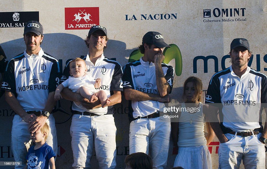 Players of La Dolfina pose with their children after a polo match between La Dolfina and Ellerstina as part of the 119th Argentina Open Polo Championship Final on December 08, 2012 in Buenos Aires, Argentina.