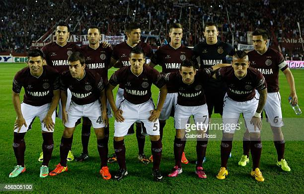 Players of Lanus pose for a team photo prior to a match between Lanus and River Plate as part of ninth round of Torneo de Transicion 2014 at Ciudad...