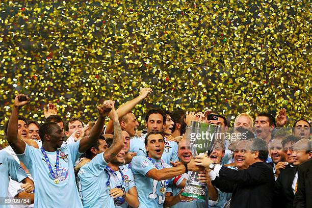 Players of Lazio celebrate with the cup after victory in the Beijing 2009 Supercup match between Inter Milan and Lazio at the Birds Nest on August 8...