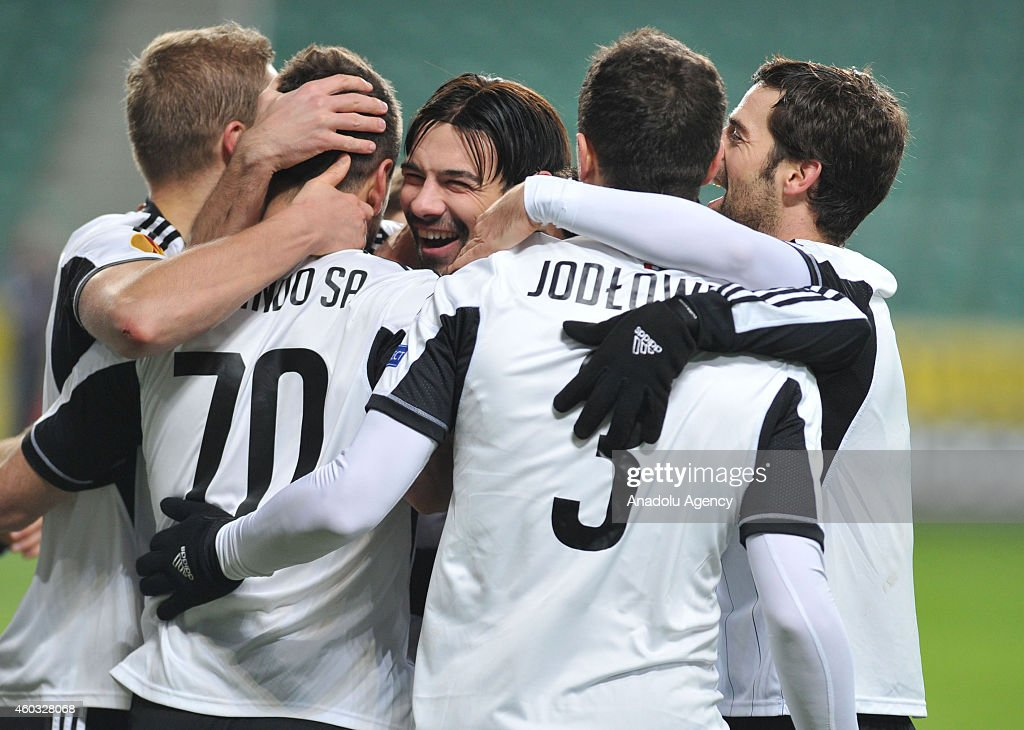 Players of Legia Warsaw celebrate after scoring during the UEFA Europa League Group L football match between Legia Warsaw and Trabzonspor AS at...