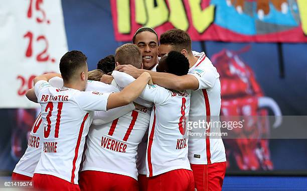 Players of Leipzig celebrate after scoring their team's opening goal during the Bundesliga match between RB Leipzig and 1 FSV Mainz 05 at Red Bull...