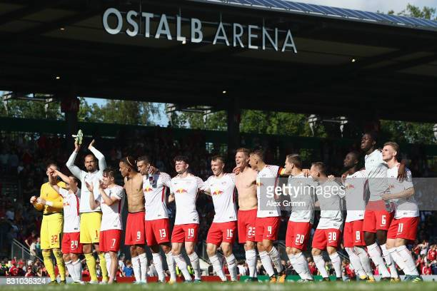 Players of Leipzig celebrate with the fans after the DFB Cup first round match between Sportfreunde Dorfmerkingen and RB Leipzig at OstalbArena on...
