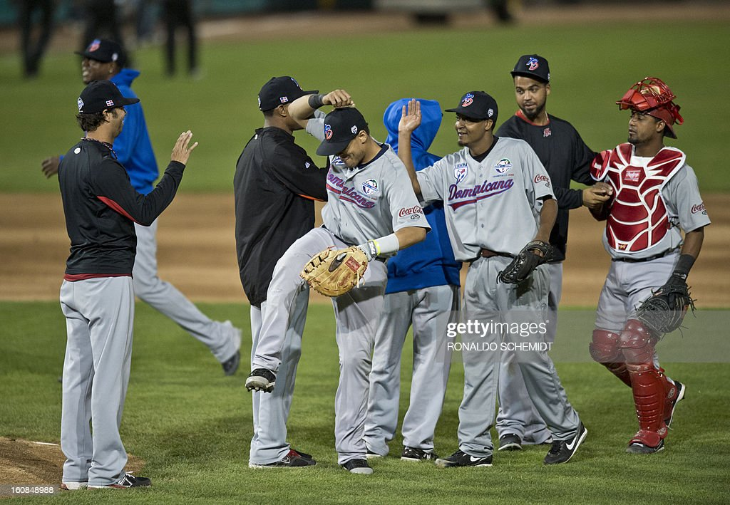 Players of Leones del Escogido of Dominican Republic, celebrates his victory against Magallanes of Venezuela, during the 2013 Caribbean baseball series, on February 6, 2013, in Hermosillo, Sonora State, in the northern of Mexico. AFP PHOTO/Ronaldo Schemidt