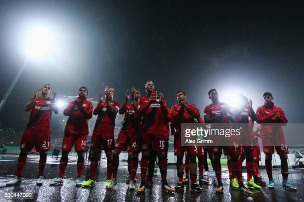 Players of Leverkusen celebrate after the DFB Cup first round match between Karlsruher SC and Bayer Leverkusen at Wildparkstadion on August 11 2017...
