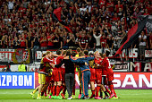 Players of LEverkusen celebrate after winning the UEFA Champions League qualifying play off round 2nd leg between Bayer Leverkusen and SS Lazio on...