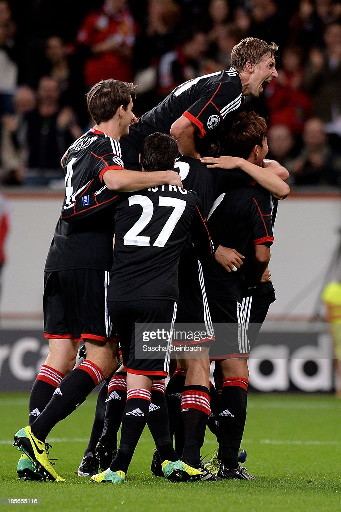 Players of Leverkusen celebrate their third goal during the UEFA Champions League Group A match between Bayer Leverkusen and Shakhtar Donetsk at BayArena on October 23, 2013 in Leverkusen, Germany.
