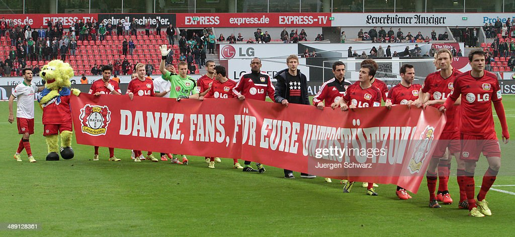 Players of Leverkusen shows a banner reading 'Thank you for your support' after the Bundesliga match between Bayer 04 Leverkusen and Werder Bremen at BayArena on May 10, 2014 in Leverkusen, Germany.