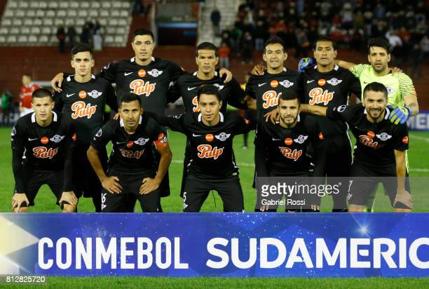 Players of Libertad pose for a photo prior the first leg match between Huracan and Libertad as part of second round of Copa Conmebol Sudamericana...