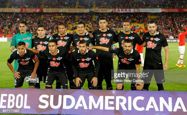 Players of Libertad pose for a team photo prior to a second leg match between Independiente Santa Fe and Libertad as part of round of 16 of Copa...