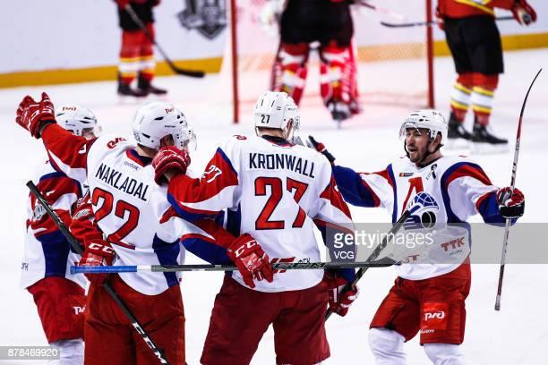 Players of Lokomotiv Yaroslavl celebrate a point during the 2017/18 Kontinental Hockey League Regular Season match between HC Kunlun Red Star and...
