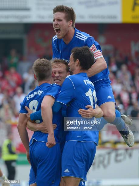 Players of Lotte celebrate their first goal during the Regionalliga West match between Sportfreunde Lotte and RW Essen at ConnectM Arena on May 19...