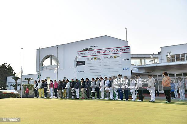 Players of LPGA stand for a moment of silence on the fifth anniversary of the Great East Japan Earthquake and following tsunami before the first...