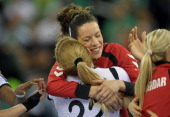 Players of Macedonian WHC Vardar SCBT Spanish Begona Fernandez Molinos and Montenegrian Andrea Klikovac celebrate their win after the EHF Final Four...