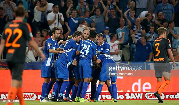 Players of Magdeburg celebrate after their team's second goal during the Third League match between 1 FC Magdeburg and FC Rot Weiss Erfurt at...