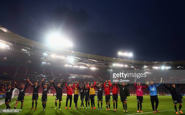 Players of Mainz celebrate with the fans after the Bundesliga match between VfB Stuttgart and 1 FSV Mainz 05 at MercedesBenz Arena on January 25 2014...