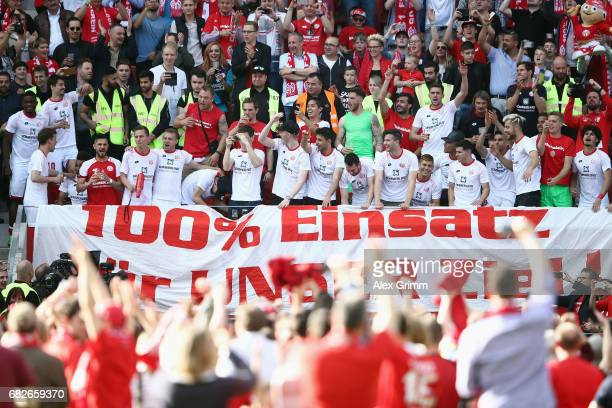 Players of Mainz celebrate with the fans after the Bundesliga match between 1 FSV Mainz 05 and Eintracht Frankfurt at Opel Arena on May 13 2017 in...