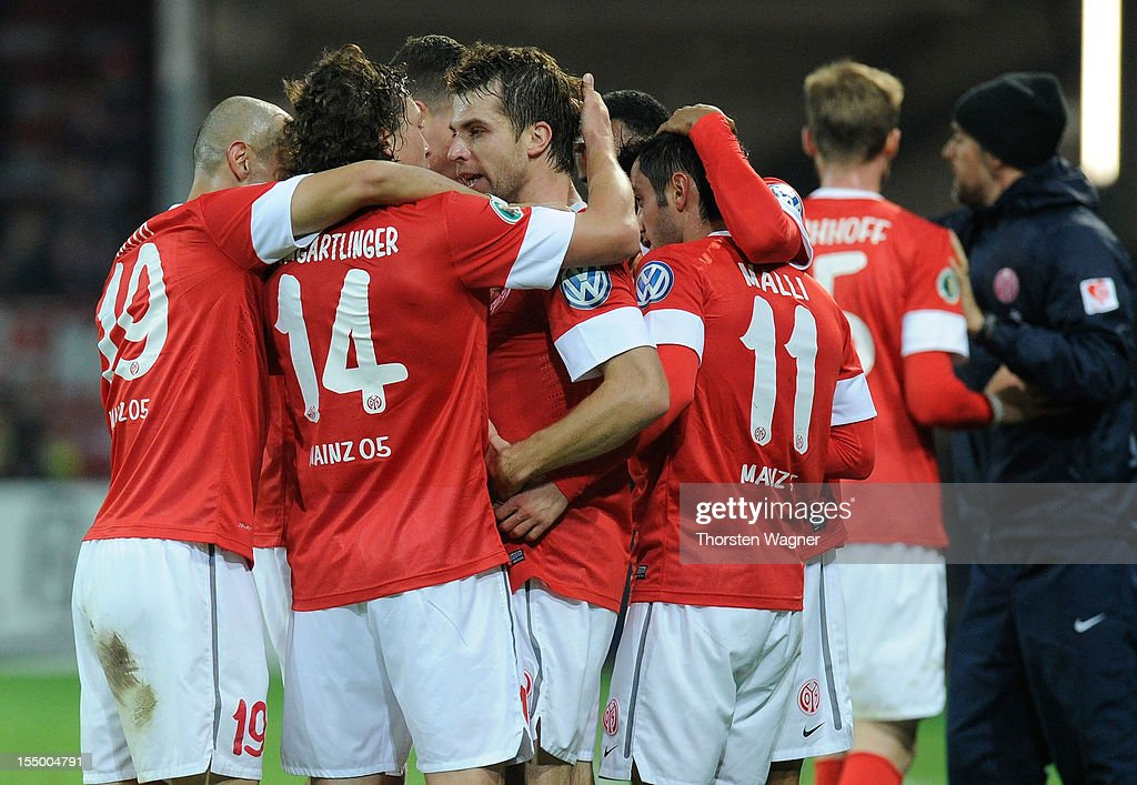 Players of Mainz celebrates after <a gi-track='captionPersonalityLinkClicked' href=/galleries/search?phrase=Andreas+Ivanschitz&family=editorial&specificpeople=2140350 ng-click='$event.stopPropagation()'>Andreas Ivanschitz</a> is scoring his teams first goal during the DFB Cup second round match between FSV Mainz 05 and FC Erzgebirge Aue at Coface Arena on October 30, 2012 in Mainz, Germany.