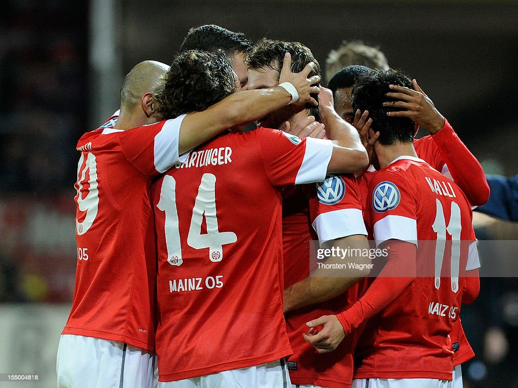 Players of Mainz celebrates after <a gi-track='captionPersonalityLinkClicked' href=/galleries/search?phrase=Andreas+Ivanschitz&family=editorial&specificpeople=2140350 ng-click='$event.stopPropagation()'>Andreas Ivanschitz</a> (C) is scoring his teams first goal during the DFB Cup second round match between FSV Mainz 05 and FC Erzgebirge Aue at Coface Arena on October 30, 2012 in Mainz, Germany.