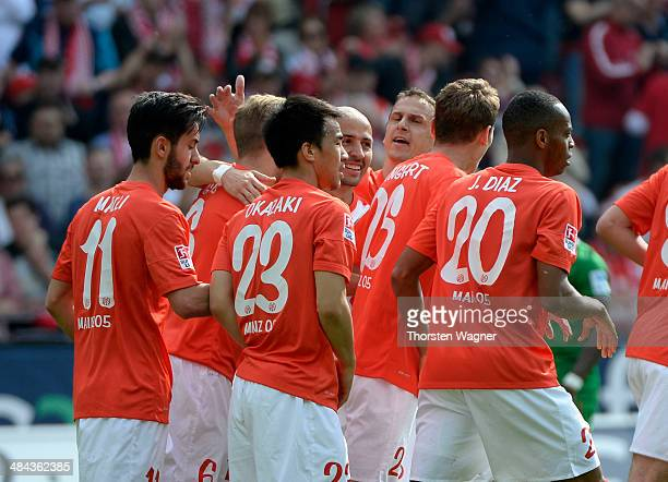 Players of Mainz celebrates after Nils Peteresen of Bremen is scoring the 10 with a own goal during the Bundesliga match between FSV Mainz 05 and SV...