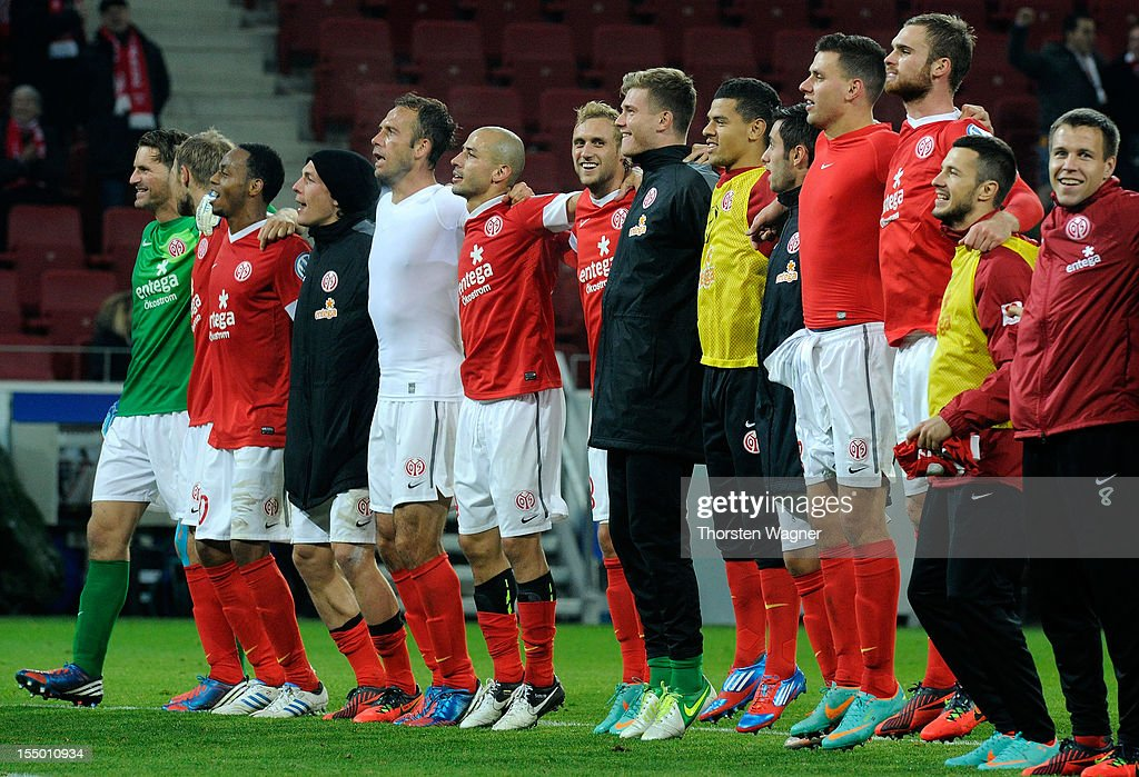 Players of Mainz celebrates after winning the DFB Cup second round match between FSV Mainz 05 and FC Erzgebirge Aue at Coface Arena on October 30, 2012 in Mainz, Germany.