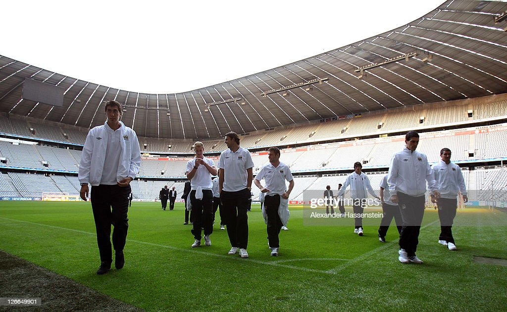 Players of Manchester City inspects the field prior to a press conference ahead of the UEFA Champions League group A first leg match against Bayern Muenchen at Allianz Arena on September 26, 2011 in Munich, Germany.