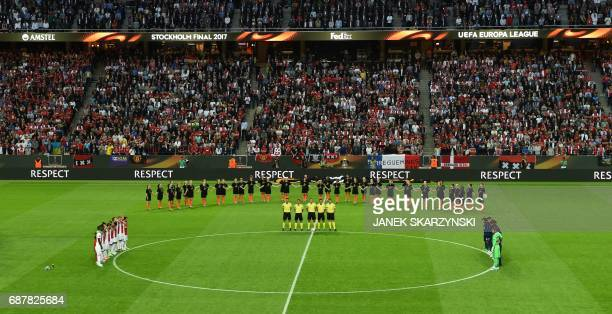 Players of Manchester United and of Ajax Amsterdam observe a minute's silence for the victims of the bomb attack in Manchester prior to the UEFA...