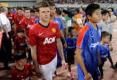 Players of Manchester United attend the match during the Friendly Match between Shanghai Shenhua and Manchester United at Shanghai Stadium on July 25...
